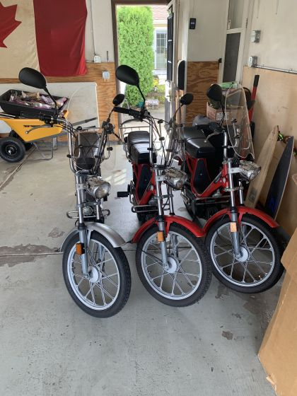 1980 Vespa Grande, Two Red and One Silver.