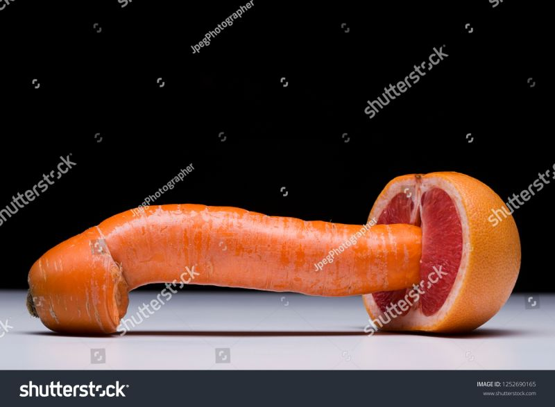 stock-photo-carrot-and-red-grapefruit-as-symbol-of-penetrative-sex-physical-intimacy-sexual-activity-metaphor-1252690165.jpg