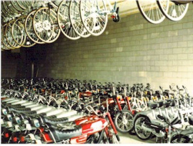 1977 Puch Magnum II, Tons of mopeds in a warehouse (low res)