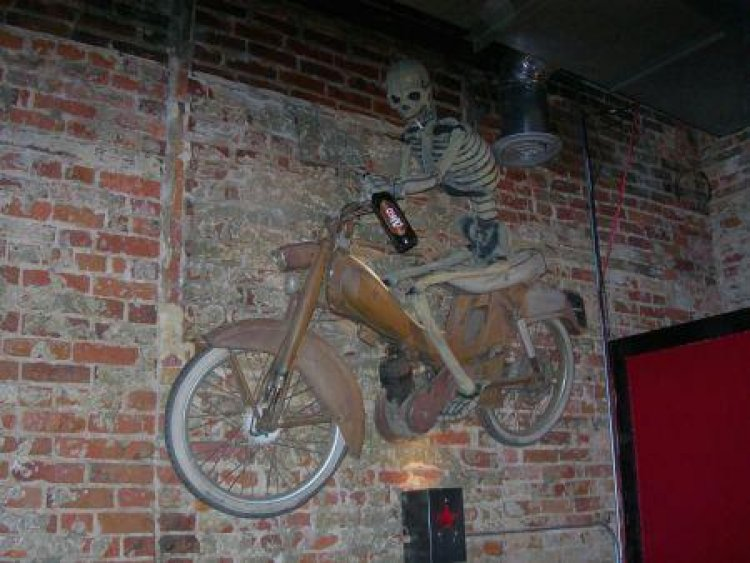 Motobecane (Skeleton moped on wall at Pravda in Wilmington, NC)