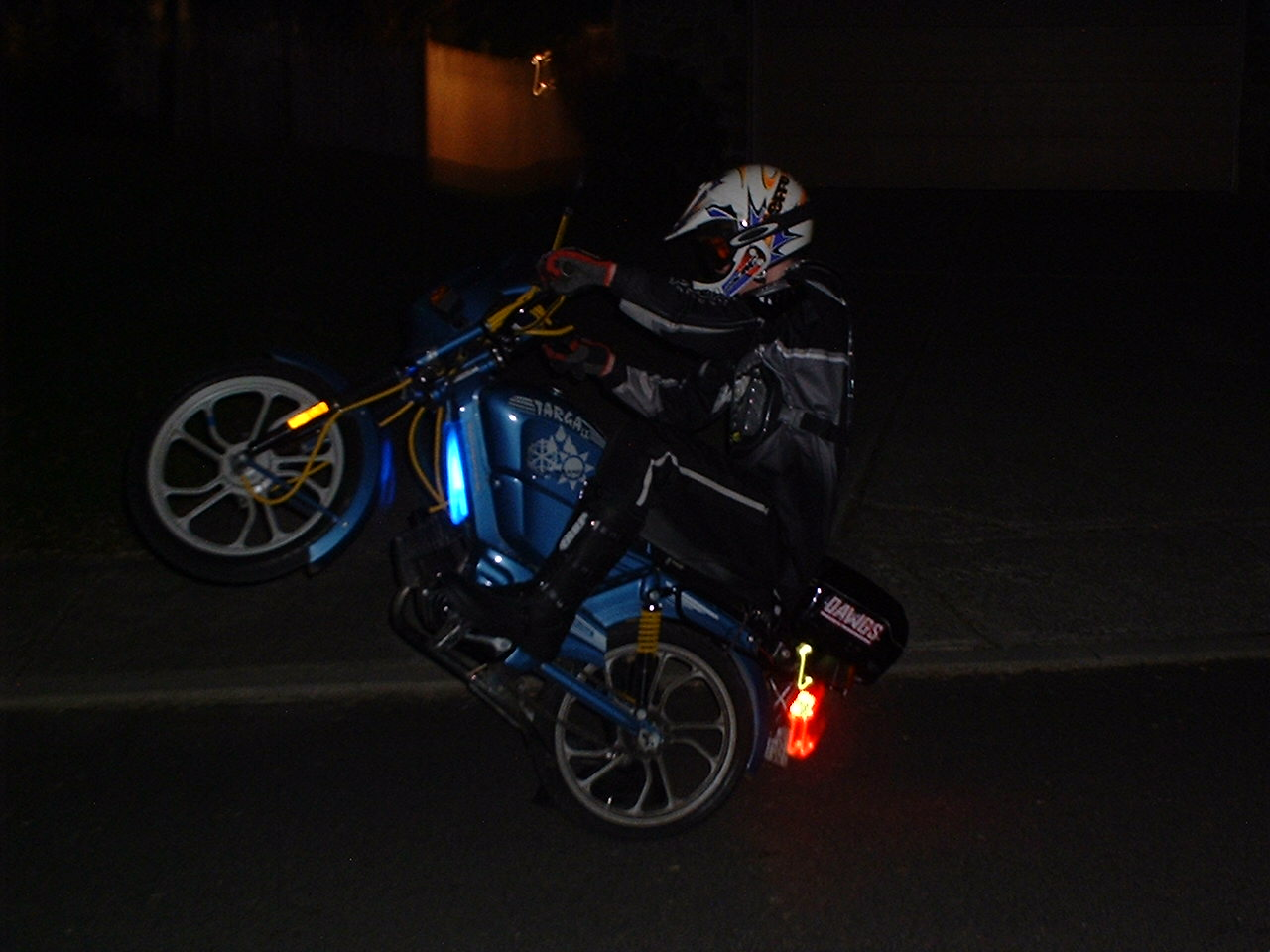 (Mike doing a wheelie on his Tomos)