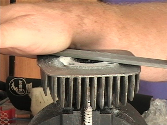 Milling the head with a file. Note technique and how the head is held in the vise.